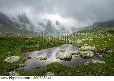 Peaks Of High Tatras And Lake In Slovakia.