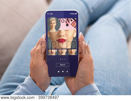 Augmented Reality Beauty App. Woman Trying Different Lipstick Color Online On Smartphone, Using Mode