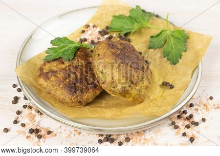 Homemade Meat Beef Burger Patties Cutlet On Grey Plate On White Table Background, Salt, Pepper, Herb