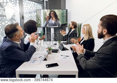 Videoconference, Telemeeting, Remote Work. Multiethnic Diverse Business Team, Sitting Around The Tab