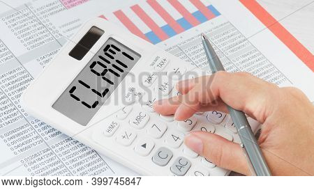 Claim Text On Calculator. Female Hand Using Calculator. Financial Claims Concept
