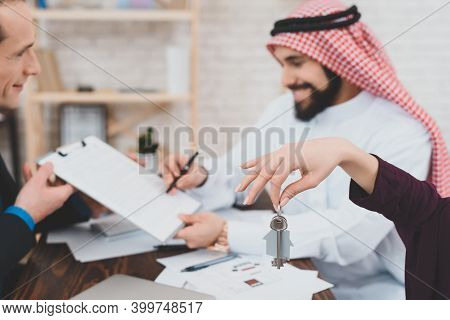 Satisfied Arab Man In Keffiyeh Typing On Laptop In Office. Arab Businessman Sitting In Office And Wo