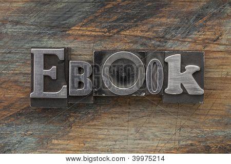 ebook word in vintage letterpress metal type on a grunge painted wood background
