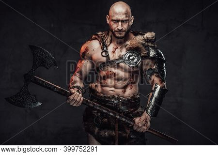 Barbaric Bald And Handsome Viking Warrior With Muscular Build And Grimy Skin Posing In Dark Backgrou