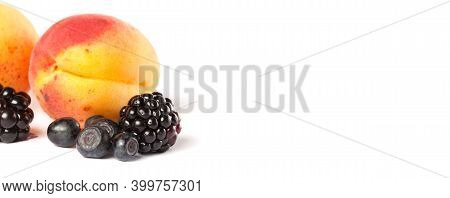 Ripe Blueberry Apricot And Blackberry On White Background. Copy Space