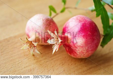 Macro Photo Of Pomegranate Fruits. Wooden Background. Shallow Depth Of Field, Selective Focus