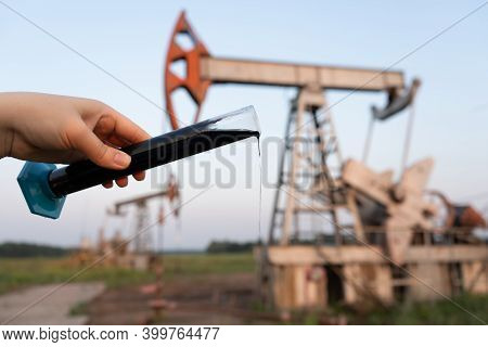 Oil Industry. A Test Tube With Crude Oil In The Hand Of An Engineer