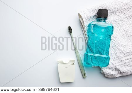 Tooth Care Concept. Mouth Rinse, Dental Floss And Toothbrush On White Background, Top View, Flat Lay
