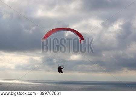 Storm Clouds And Paraglider Above Whitsand Bay, Cornwall
