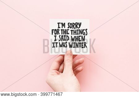 Minimal Composition On A Pink Pastel Background With Girls Hand Holding Card With Quote Im Sorry For