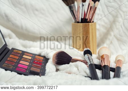 Collection Of Professional Makeup Brushes And Eyeshadow Palette