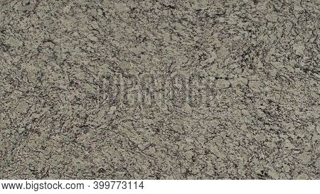 Natural Cobbles Brown Granite Stone Texture Background. Cobbles Brown Granite Surface For Interior A