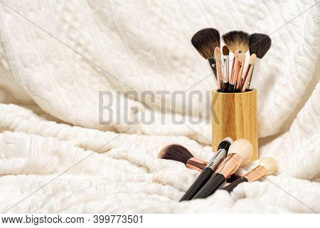 A Set Of Makeup Brushes On A Soft Light Cloth. Visage Concept