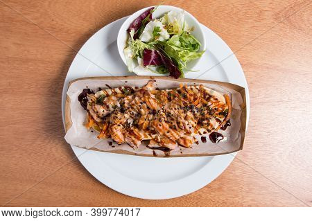 Toast Made On The Basis Of Salted Biscuit With Salmon And Vegetables. Street Modern Food.