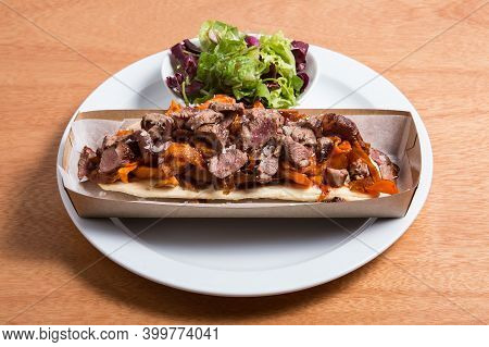 Toast Made On The Basis Of Salted Biscuit With Beef And Vegetables. Street Modern Food.