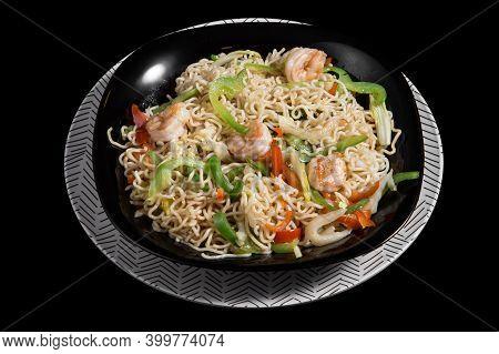 Japanese Noodles Yakisoba With Shrimp On A Black Plate