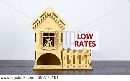 Low Rates Symbol. Words 'low Rates' On White Paper Card. Model Of A Wooden House. Copy Space. Busine