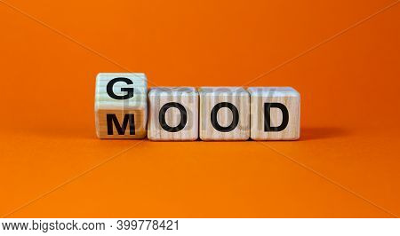 Good Mood Symbol. Fliped A Wooden Cube And Changed The Word 'good' To 'mood'. Beautiful Orange Backg