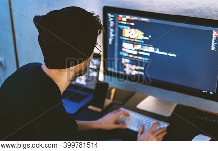 Young Man Mobile Developer Writes Program Code On A Computer, Programmer Work In Home Office. High Q