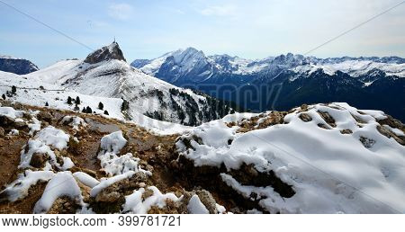 Winter mountain landscape in Dolomites Alps. View on Col Rodella peak and mount Marmolada. South Tyrol, Italy.
