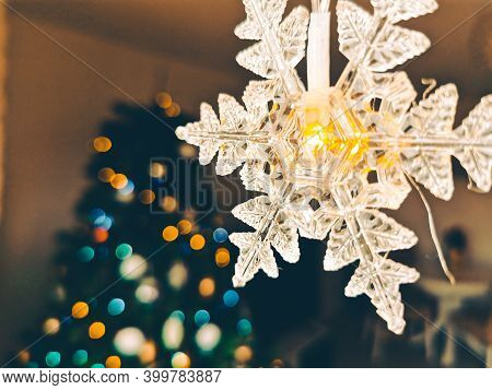 Cosy Atmosphere For Christmas With Christmas Lights In Foreground And Bokeh Effect On Christmas Tree