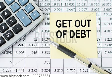 Paper Note With Text Get Out Of Debt On The Office Table