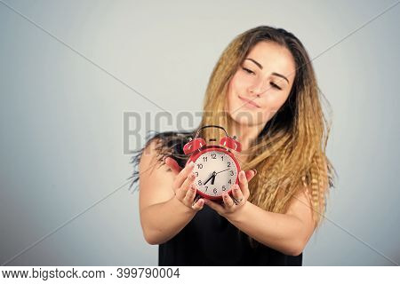 Keeping Track Of Time. Punctuality And Discipline. Girl Hold Alarm Clock. Regime Early Awakening. Be