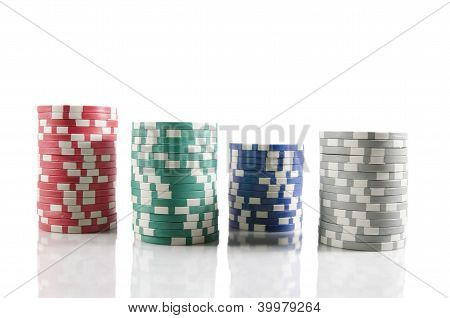 Stack Of Poker Chips. Red, Blue,green, And Grey Chips Over White Isolated Background.