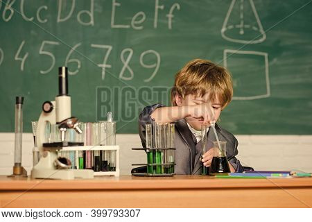 Knowledge Concept. Fascinating Subject. Knowledge Day. Kid Study Biology Chemistry. Boy Microscope A