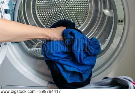 Washing Machine For Clothes, Woman Hand Loads Tumble Dryer And Tumble Dryer