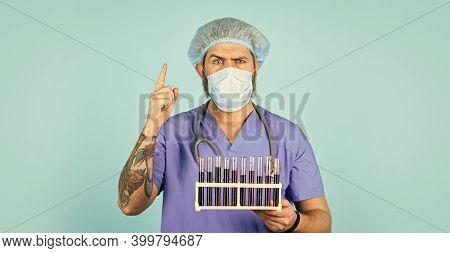 Quarantine Plans. Epidemic Threshold. Medical Research. Man In Medical Lab Inspecting Samples Biolog