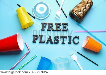 Plastic Tableware And Text Free Plastic On Color Background. Ecology Concept