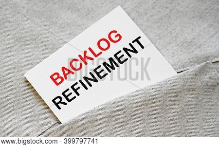 Backlog Refinement Text On The White Sticker In The Shirt Pocket.