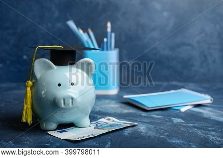 Piggy Bank With Graduation Hat And Money On Table. Tuition Fees Concept