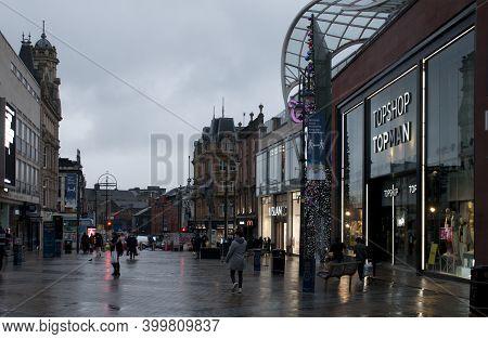 Leeds, West Yorkshire, United Kingdom - 03 December 2020: People Walking Outside The Topshop Fashion