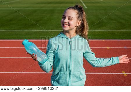 Teen Girl Drink Water While Training And Running On Outdoor Stadium, Thirsty