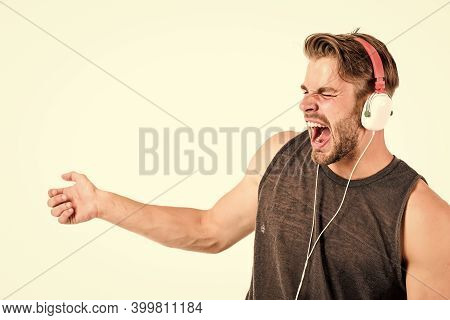 Start This Party. Man Handsome Dj Using Modern Headphones. Professional Musical Software And Devices