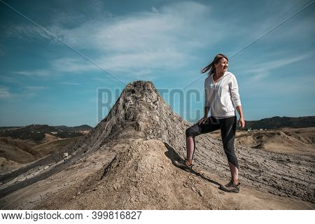 Young Girl Conquering A Mountain Peak Wearing Sportswear