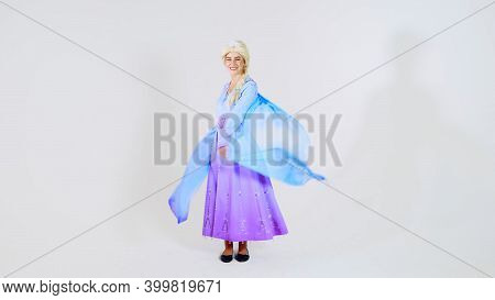 Moscow, Russia - December 6 2020: Portrait Of A Young Cute Girl In A Beautiful Princess Elsa Costume