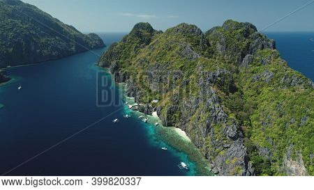 Relax seascape with water transport of El Nido Islets, Palawan, Philippines, Asia. Philippines Hill Highland Islands at ocean gulf aerial view. Cinematic summer tourism in soft light shot