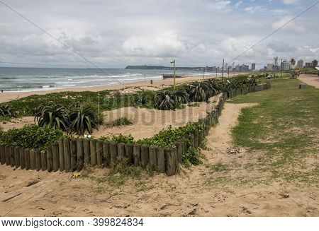 Wooden Pillarrs Holding Back Beach Sand At Durban, South Africa