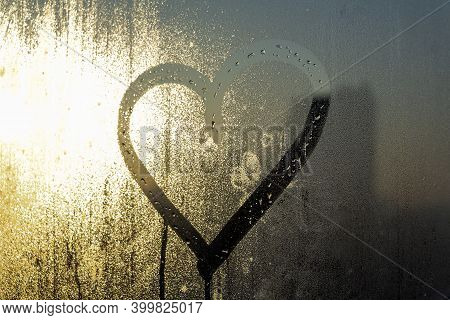 Blurred Shiny Background. Valentine's Day Concept. Inscription Heart Shape Drawn On Sweaty And Frost