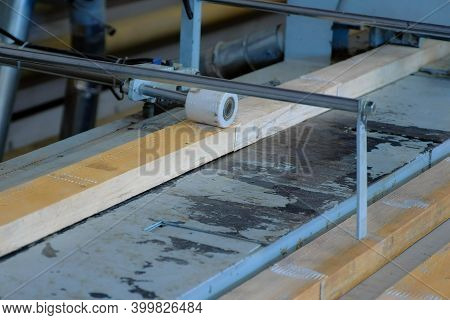 Production Of Laminated Veneer Lumber On Plant On Cutting Machine Equipment. The Production Line For