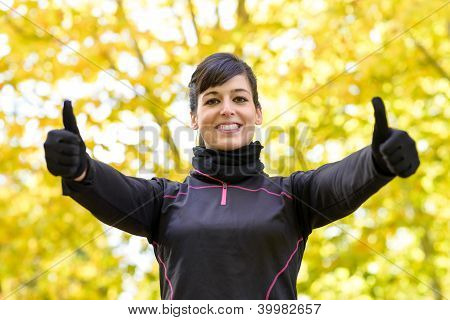 Success Sportwoman With Thumbs Up