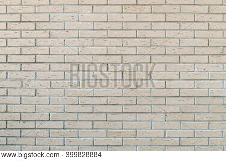 Smooth Facing Brick. Brick Wall With Gray Decorative Tile Seams For Wall Decoration. Background Text