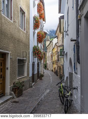 Brixen, Italy - October 5, 2020: Small Street In The City Of Brixen, Bressanone, With Yellow Houses