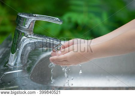 Hands Open For Drinking Tap Water. Pouring Fresh Healthy Drink. Good Habit. Right Choice. Child Wash