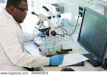 African-american Man Working In Lab. Scientist Doctor Making Medical Research. Laboratory Tools: Mic