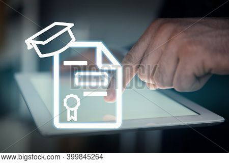 Online Learning Concept. Diploma Icon On Foreground And Man Using Tablet, Closeup