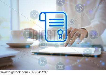 Online Learning Concept. Diploma With Other Icons On Foreground And Woman Using Tablet, Closeup